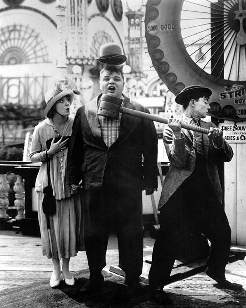 "mothgirlwings:  Buster with Alice Lake and Roscoe ""Fatty"" Arbuckle in Coney Island (1917)"