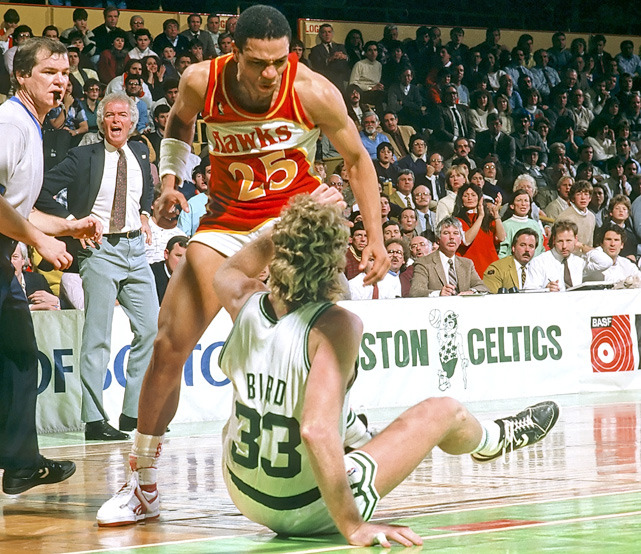 siphotos:  Hawks guard Doc Rivers is less than pleased with Larry Bird as the two tangle during a 1987 Celtics-Hawks game. (Corbis)