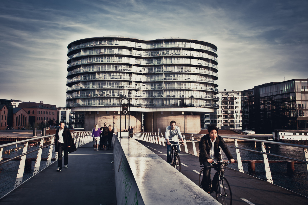 Bicycle bridge in Copenhagen on Flickr. Going back to visit Copenhagen for the first time in 7 months, it really strikes you how bicycle culture is so deeply rooted in the city.  By bicycle you can literately go from anywhere to anywhere in the city within the space of 20 minutes. But the biggest difference between London and Copenhagen is how socially recognized it is, even to ride your bicycle into the night life. Something many Londoners find silly.