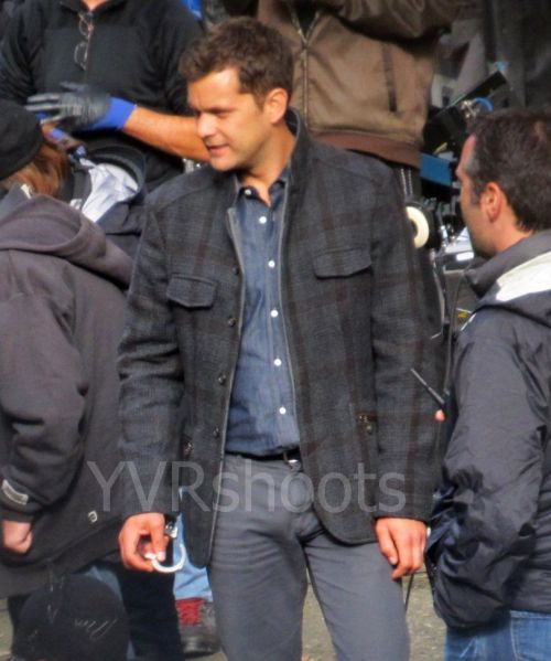 yvrshoots:  Fringe's Joshua Jackson has a new pea coat on location in Vancouver From Susan Gittins's Flickr photostream  If you look at this picture long enough you'll also notice his adorable face is in it too.