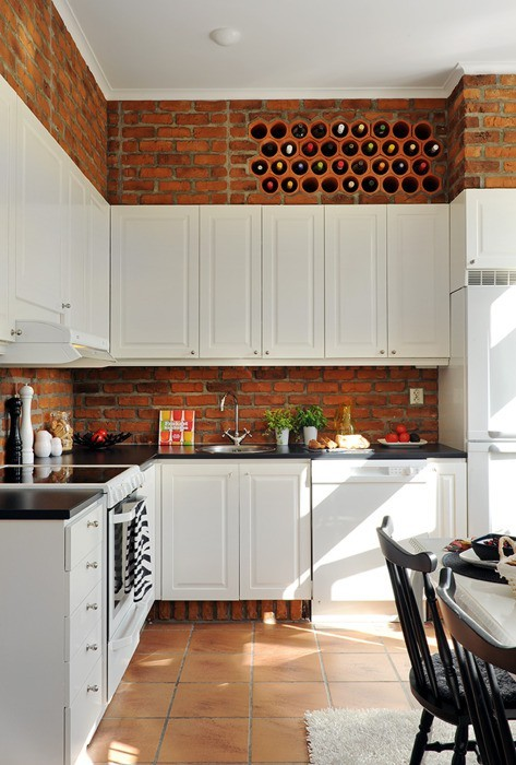 Brick kitchen with built-in wine rack.
