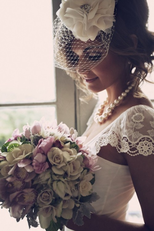 Mmm…love the veil.  And the pretty sleeves. *day-dreams*