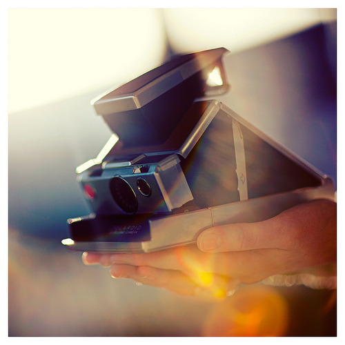 photojojo:  Photographic proof that the folding SX-70 Polaroid camera was brought to us directly from heaven. (Photo by Photography King ♛ on Flickr)