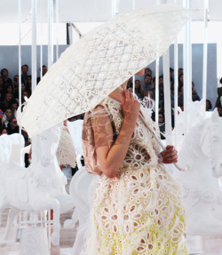 glamour:  Preparing for spring showers (as in both rain and babies) at Louis Vuitton, spring 2012