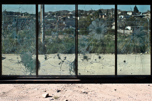 matimilstein:  Through the Looking Glass  The Mexican city of Juarez as seen through a bullet-pocked protective barrier from the American side of the international border. Ciudad Juarez has been plagued by drug-related violence and thousands of murders over the past several years.      why do women wear thong panties