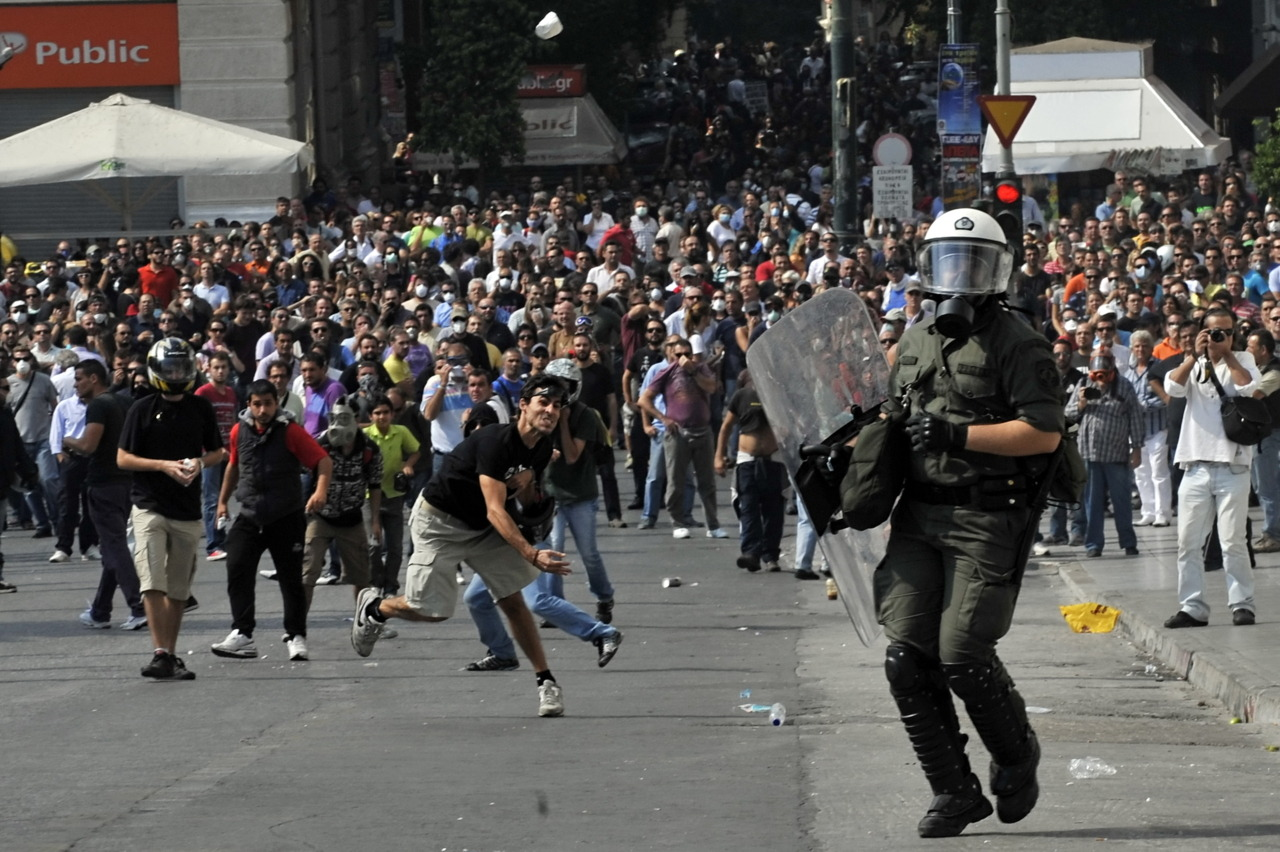 Thousands strike in Greece to protest government cutsPolice fired tear gas at stone-throwing youths in central Athens on Wednesday, where thousands of striking state sector workers marched against cuts the government says are needed to save the nation from bankruptcy.Youths broke up marble paving slabs and hurled the chunks of rock at police in full riot gear. The police responded by firing tear gas grenades, chasing the protesters through the square into surrounding streets. (Photo: Louisa Gouliamaki/AFP/Getty Images)