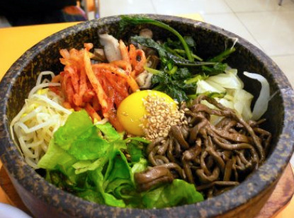 heykata:  clubmonaco:   Dok Suni  An East Village Korean cuisine restaurant offers the best bibimbap and tasty dishes for anyone looking to try something different.  I need this right now.  Drool.