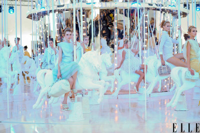 elle:  Paris Fashion Week The carousel scene at the Louis Vuitton show this morning. Can you spot the newly wed model that closed the show…? Photo: Imaxtree