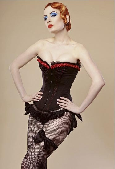 CORSETPUNK  A RedHeaded, Gothic, be-corseted, stiletto heeled vamp of The Clogiron Appreciation Society. If only. It is Ulorin Vex
