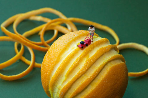 """Citrus mower"" by Christopher Boffoli. The Seattle-based artist aims to highlight America's culture of over-consumption, using hand painted railway model figurines glued into place onto real food"