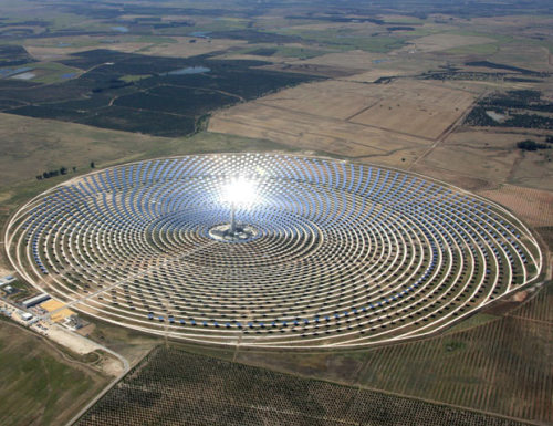 MIRRORS, MIRRORS    An aerial view of the Torresol Energy Gemasolar thermosolar plant in Fuentes de Andalucia near Seville, southern Spain.  Rings of reflective panels focus sunlight on the central tower, which uses the energy generated to power steam turbines, creating electricity. (Photo: AFP-Getty via the Telegraph) That's hot.  And pretty cool.