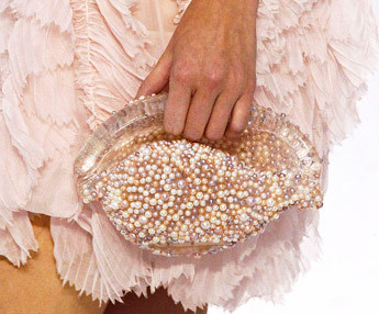 Chanel sent pearl covered conch shell bags down their Spring 2012 runway