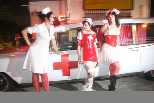 Art of Bleeding nurses (Anise Teasia, Poppy, Amputette) with ambulance at Linda Vista Hospital. (PHOTO: Melissa Tremblay)