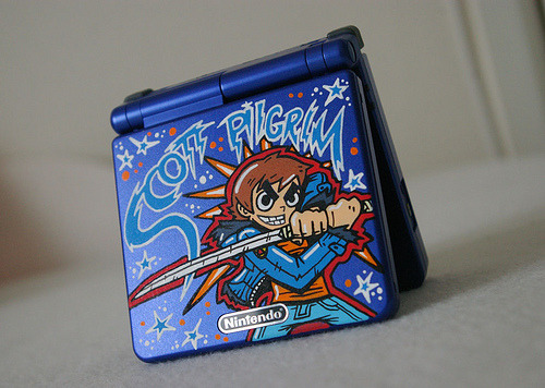 Limited Edition Scott Pilgrim Game Boy Advance SP One of a kind custom Scott Pilgrim GBASP by the one and only OSKUNK. Check out his site custom-art.blogspot.com for more radness.