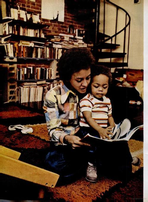 Nikki Giovanni reading to her son.