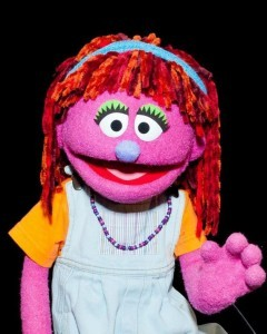 "Meet Lily, Sesame Street's ""poverty-stricken"" Muppet who will star in a one-hour prime-time special (airing Oct. 9) that aims to teach kids about poverty and hunger. In the special, Lily reveals that ""sometimes I go  with my family to the food pantry."" That really affects fellow-Muppet  Elmo. ""Elmo never has to think about where his next meal is coming  from."""