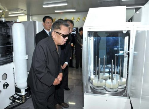 kimjongillookingatthings:looking at a dvd labeling machine