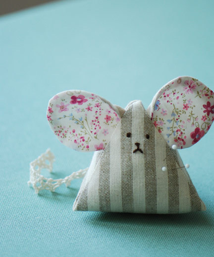 DIY Mouse Pincushion. I chose this photo because the mouse seemed to look a little upset with pins sticking out of his chest. Really good detailed video tutorial and a PDF Download tutorial (with felt ears that take a lot less time) at The Long Thread here.