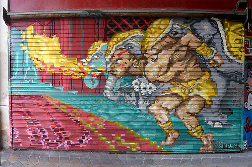 albotas:  Daily Graffiti: Yoga Fire! Freaking SICK Dhalsim pixel graffiti by Keumar. (photo via lepublicnme) Check out the DAILY GRAFFITI ARCHIVES for more geektastic street art!