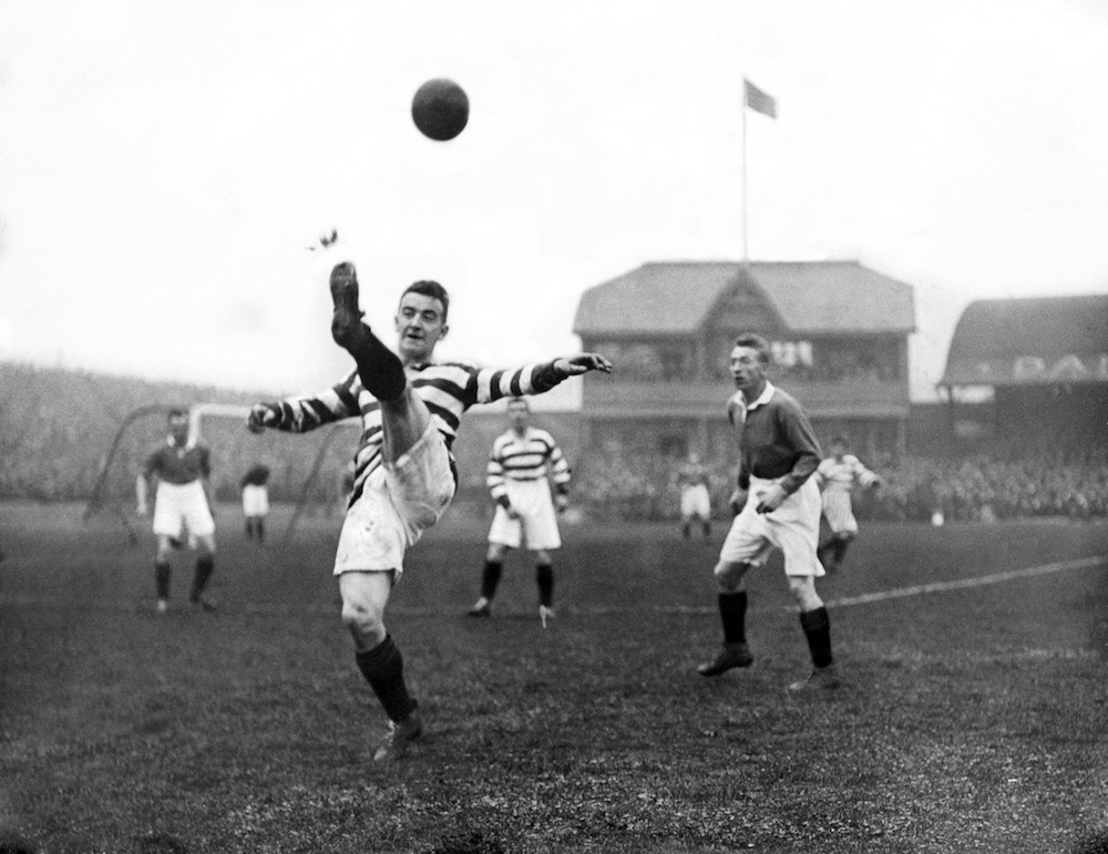 thefootballarchivist:  October 1924: Celtic's Tommy McInally kicks the ball over his head during an Old Firm derby.