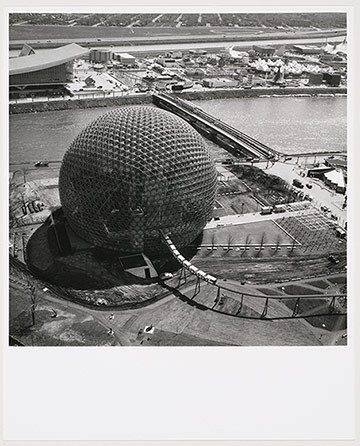 R. BUCKMINSTER FULLER United States Pavilion under construction, Expo 67, Montréal, Québec. Aerial view towards the South. In the afternoon of the 20 May 1976, during structural renovations, a fire burned away the building's transparent acrylic bubble. Today is a museum dedicated to the envirnonment, the Montreal Biosphère.