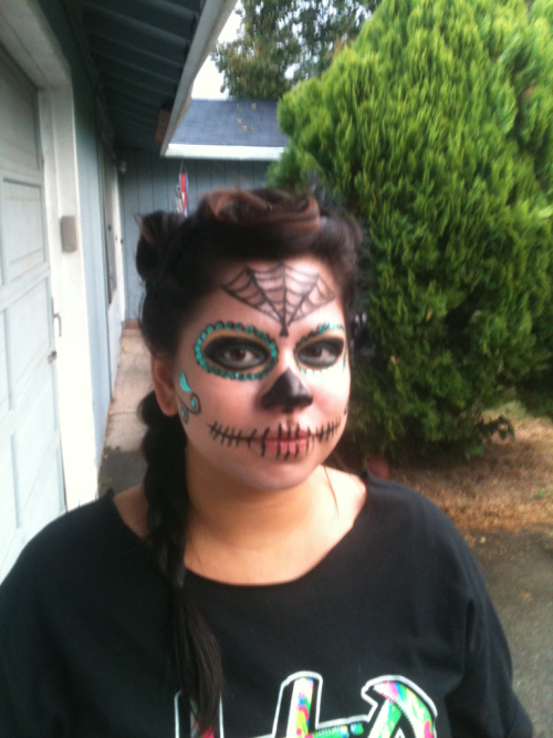 My crazily amazing girlfriend getting ready for Dias de Los muertos! She keeps me sane. :)