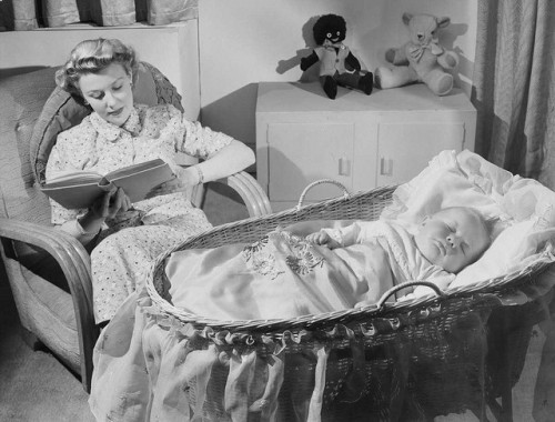 Woman reads as baby sleeps by National Media Museum on Flickr.