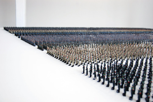 "(via Designboom)  ""Tin Soldiers"" is an installation which depicts the nine armies that were implicated in, or subject to, acts of war in today's Middle East. The pieces are produced in numbers proportional to those of active  troops in 2010. Each of the featured armies are cast from the same mould and hand-painted in the military outfits of Egypt, Iran, Iraq, Israel, Jordan, Lebanon, Palestine, Syria and Turkey. A total of 12,235 soldiers  at a scale of 1:200 are arranged in a systematic platform, in a way acting as a multistage exploration of the results of the instrumentalizing of individuals through political and economic agendas."
