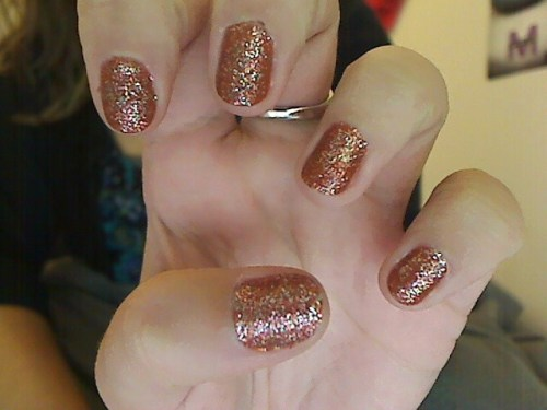 "Look how ""Fall"" my nails are! Rusty orange with Fall colored sparkles :)"