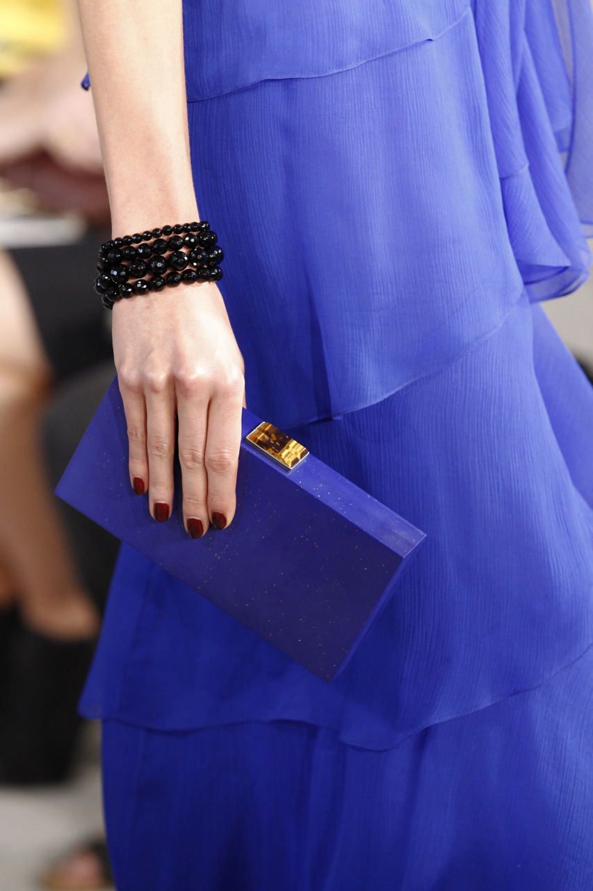 this clutch. hand-carved lapis stone with tigereye closure. It's stone. heavy as hell and out of this world.
