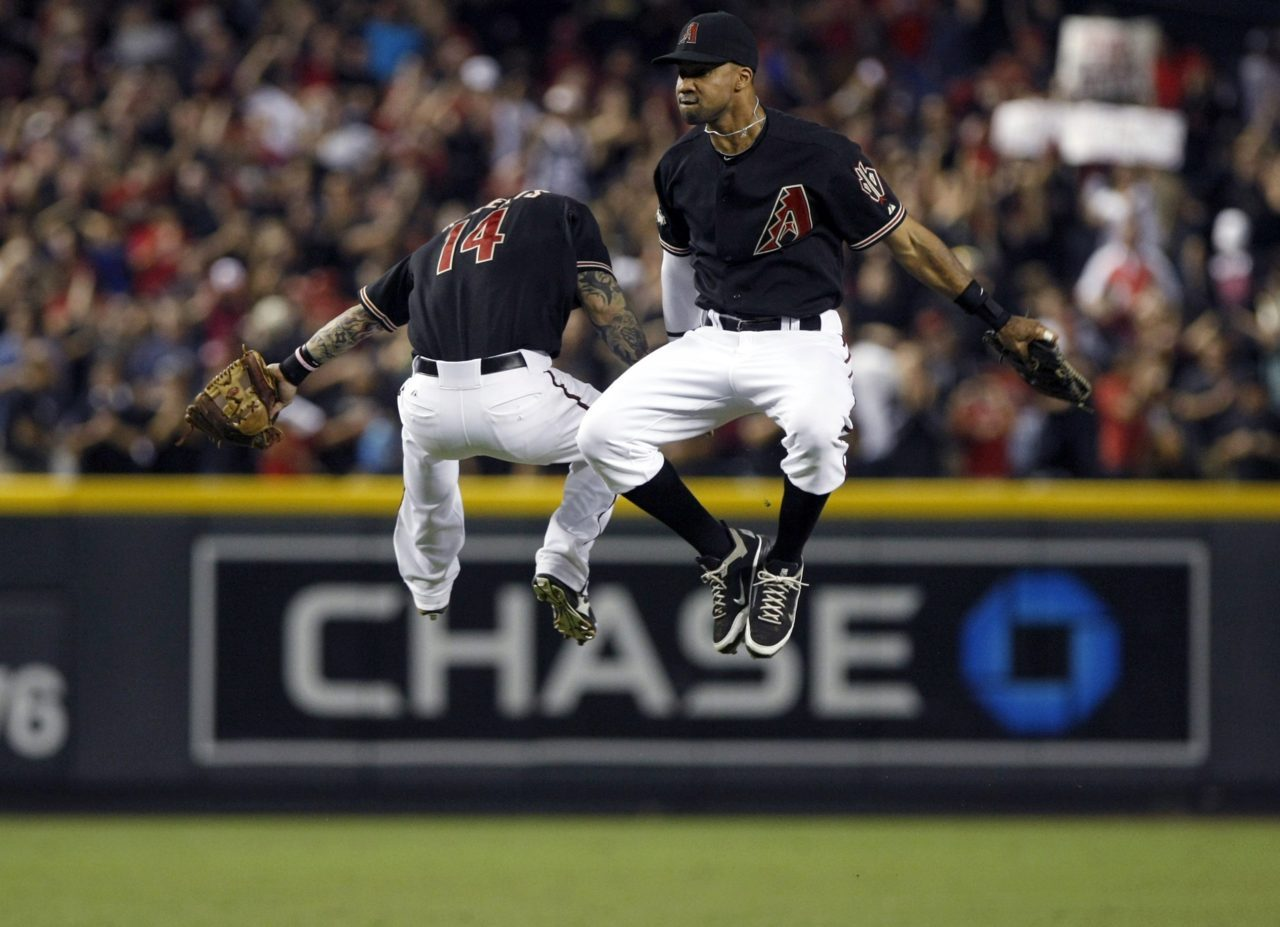 Arizona Diamondbacks Ryan Roberts jumps into the air with teammate Chris Young after defeating the Milwaukee Brewers in Game 4. REUTERS/Rick Scuteri