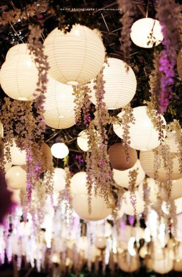 Reception decor - hanging lanterns and wisteria (via Rani & Tossie | Axioo)