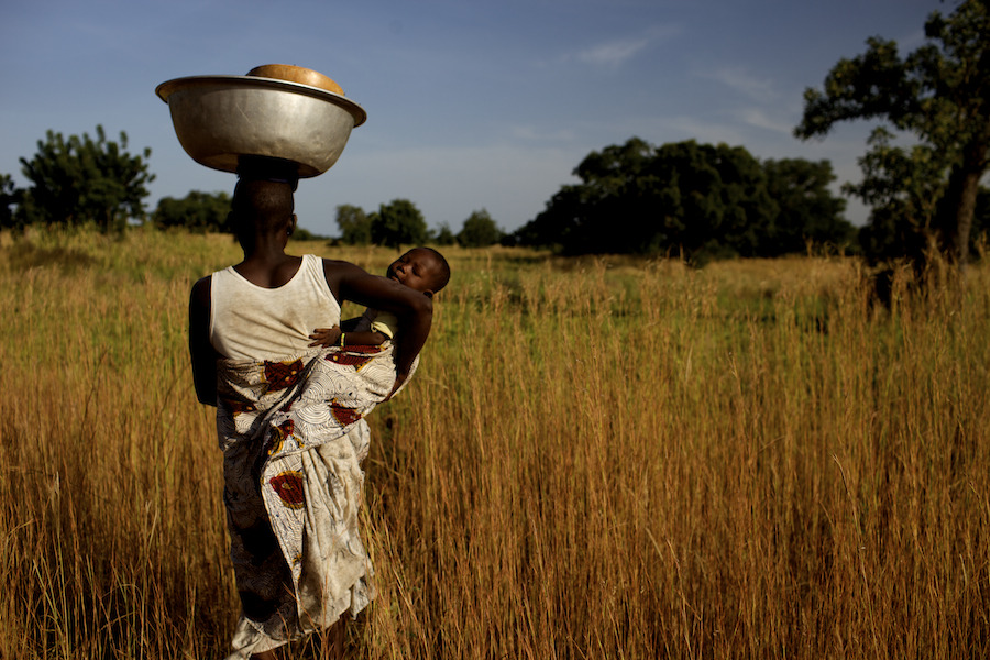 "doctorswithoutborders:  Known as the ""hunger gap,"" rural malnutrition recurs seasonally in Burkina Faso when crops are scarce and the 80 percent of Burkinabe who depend on subsistence farming lose their primary source of nourishment. In the Starved for Attention Film ""A Mother's Devotion,"" photojournalist Jessica Dimmock tenderly captures the heartbreaking emotional strains experienced by a young, hard working mother, Natasha, simply trying to feed her children. Alone at 24, she scavenges firewood to sell in the market.  Her meager earnings force an impossible choice: between buying food or medicine for her three children. This is one of 195 million stories of malnutrition. Sign the petition and donate your profile to help us rewrite the story. Photo: Burkina Faso 2009 © Jessica Dimmock/VII"