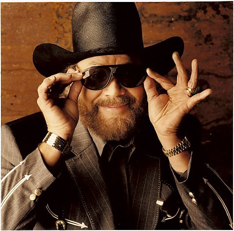 "(ESPN) — Hank Williams Jr. and his iconic theme song will not return to ESPN's ""Monday Night Football,"" the network announced Thursday.  In the wake of Williams using an analogy involving Adolf Hitler and President Barack Obama to make a political point on the Fox News Channel, Williams' ""All My Rowdy Friends"" will no longer be part of the MNF opening. ""We have decided to part ways with Hank Williams, Jr,"" ESPN said in a statement. ""We appreciate his contributions over the past years. The success of Monday Night Football has always been about the games and that will continue."" On his own website, Williams said he was the one who made the decision. ""After reading hundreds of e-mails, I have made MY decision,"" he wrote. ""By pulling my opening Oct 3rd, You (ESPN) stepped on the Toes of The First Amendment Freedom of Speech, so therefore Me, My Song, and All My Rowdy Friends are OUT OF HERE. It's been a great run."" Hear Hank Williams Jr.'s A Country Boy Can Survive In an interview Monday on Fox News' ""Fox & Friends,"" Williams, unprompted, said of Obama's outing on the links with House Speaker John Boehner: ""It'd be like Hitler playing golf with (Israeli Prime Minister Benjamin) Netanyahu."" Asked to clarify, Williams said, ""They're the enemy,"" adding that by ""they"" he meant Obama and Vice President Joe Biden. ESPN pulled Williams' opening to Monday night's Indianapolis-Tampa Bay game and issued a statement saying: ""While Hank Williams, Jr. is not an ESPN employee, we recognize that he is closely linked to our company through the open to Monday Night Football. We are extremely disappointed with his comments, and as a result we have decided to pull the open from tonight's telecast."" Williams, through his publicist, said on Monday: ""Some of us have strong opinions and are often misunderstood. My analogy was extreme — but it was to make a point. I was simply trying to explain how stupid it seemed to me — how ludicrous that pairing was. They're polar opposites and it made no sense. They don't see eye-to-eye and never will. I have always respected the office of the president."" Tuesday, he issued another statement.""The thought of the leaders of both parties jukin and high fiven on a golf course, while so many families are struggling to get by simply made me boil over and make a dumb statement,"" Williams wrote on Facebook and his website. ""I am very sorry if it offended anyone."" Williams' song has been part of ""Monday Night Football"" since 1991 on both ESPN and ABC. He is a Grammy award winner who also was a three-time entertainer of the year from the Academy of Country Music in the 1980s. Original Article"