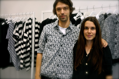 "Dévastée S/S 12 Paris, FR   In the showroom of designers Ophelie Klere and Francois Alary of Dévastée.   CS:  What was your vision, and your inspiration for the collection?  OPHELIE:  ""Devastee has many principles – codes – like black and white, shapes, very quite street, classical…and also very, very graphical pictures.  So the inspiration more for this coll is about and started from a book with many, many letters of Andre Breton, the French surrealism artist.  When he wrote to his daughter, Aube, so from ""Lettres a` Aube"", and he sent many cards with landscapes from the South of Frances where he was spending all of his summers.  So that's the place where we have grown, so we have created dresses with big landscapes, and stuff like that.  That's the first point where we started from…After we add silver prints or silver touches, and many things.""    CS:  That silver coat looked incredible on the runway, with the bodysuit underneath.   OPHELIE:  Smiles.  ""We were looking into transparence, and different techniques of fabrics where you hide the threads and you get a kind of lace, but its not lace, its just an effect of the fabric.""   CS:  Could you tell me more about the materials for the collection, is it mostly silk?   OPHELIE:  ""The collection is mostly silk for the summer, we wanted to keep the natural fabrics…the silver is not paint, it is the threads.""      CS:  I loved the models that you chose, like the girl with the short blonde hair.    What did you think about when you were going into model casting?   FRANCOIS:   ""We wanted really girly models, very feminine.  Because the concept of the collection is symmetries and the themes are quite hard with something that could be sad, so we wanted the girls to be very feminine and happy, and kind of joyful girls.  It would not have been the same at all with gothic girls with black hair – it would be too much.""   CS:  Our magazine is published in Asia.  Are you selling in Asia yet, or do you plan to?   FRANCOIS:  ""Yes, most of our customers are in Asia.   Many in Japan, China, Taipei, Korea.""    ""Hong Kong,"" adds Ophelie."