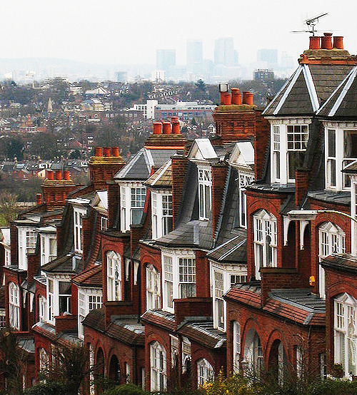enchantedengland:    The Edwardian houses of steep Muswell Hill, a suburban street in the north part of greater London, England. The background view is Canary Wharf; one of London's major business districts. (image by wikimedia)