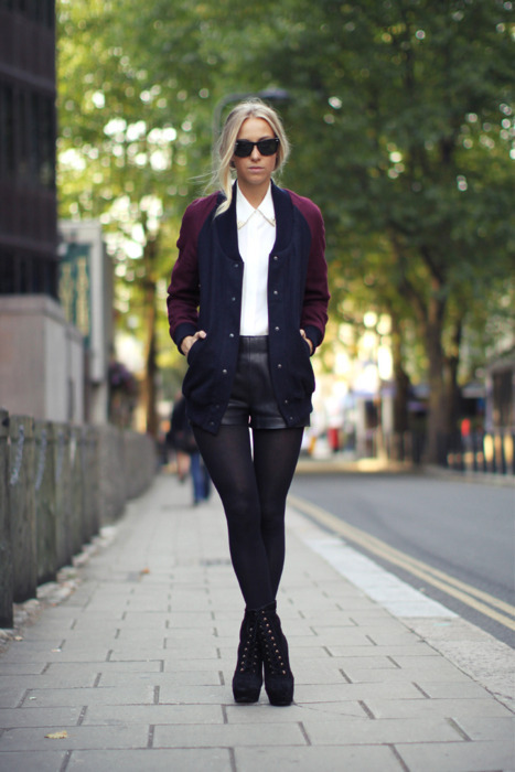 How to wear a varsity jacket in a feminine way ! We're loving the crisp white button down and leather shorts. Fab, fab, fab.