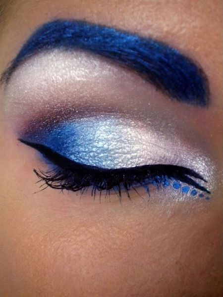 Check out Beautylish Beauty Tereska H.'s vibrant blue cat eye makeup - and with matching brows! Are you a fan of the colored brows trend?