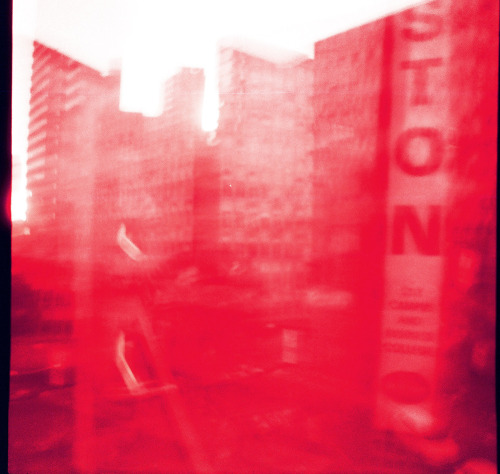 One of my recent photos. The redscale film I used gave me this rad, pink, messy, city shot. Kinda love it.