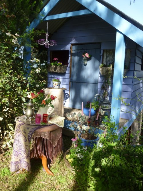 The backyard children's playhouse, abandoned, becomes a gypsy caravan for garden get-aways.