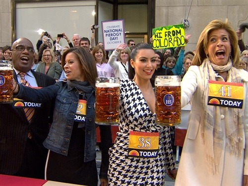 Fun fact: Kim and Hoda are experiencing the same amount of anguish in this photo, but you know, plastic surgery and all. [Today Show Had A Beer Stein Holding Contest This Morning]