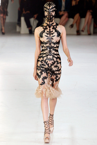 Alexander McQueen Spring RTW 2012 Paris Fashion Week Model: Nadine Ponce  Love this look. A dress of leather cut in lace patterns on chiffon.