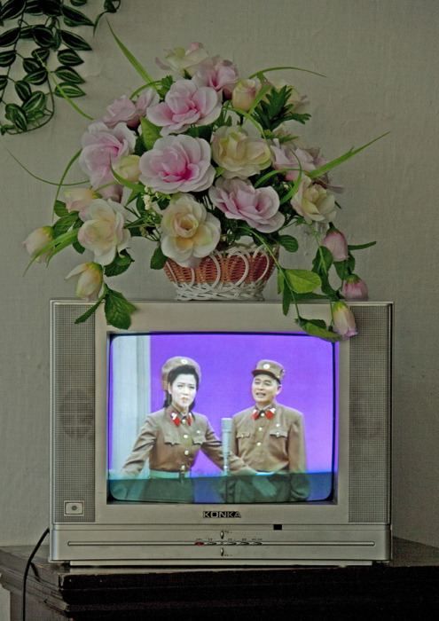 sad1:     North Korean Television There are 2 TV channels in North Korea: one which shows archives of Kim Il Sung with presidents from last century, the other which broadcasts songs, shows, military events, old propaganda movies, all dedicated to the glory of North Korea.
