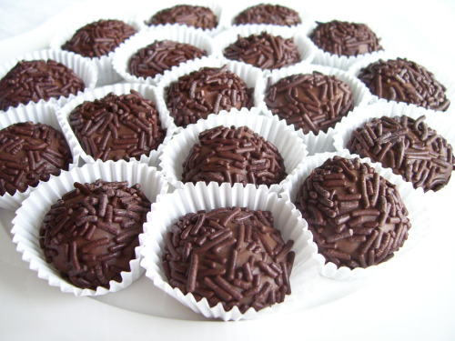 Brigadeiro! (from Technicolor Kitchen)makes about 40 Brazil rise up!!!!!!!! This one is for you! One of my lovely brazillian followers suggested this recipe (douxjardin)… and I of course I had to say yes! One of my goals in life is to learn to speak the language and live there for a few months! We'll see…. :) muito obrigado!!!!!!! 1 can sweetened condensed milk 1 tbs butter 2 tbs cocoa powder chocolate sprinkles small paper cups Directions: Grease a plate or baking sheet.Mix the milk, butter and cocoa powder in a saucepan and cook over low heat, stirring constantly.  Remove from heat when the bottom of the pan starts to show when you scrape it with the stirring spoon the mixture should have become thicker. Pour the mixture onto the greased plate or baking sheet. Let it cool completely. Butter your hand lightly and roll the mixture into 2 cm balls. Roll each ball in chocolate sprinkles and place it in a small paper cup. Recipe Credit Need more help? contact me @thecakebar I love to help!