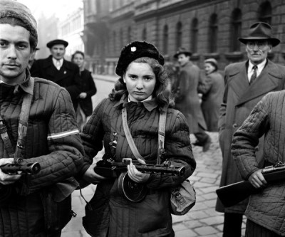 Erika, 15, a Hungarian Freedom Fighter, carries a machine gun in Budapest during the revolution, 1956, she was eventually shot by the Soviets