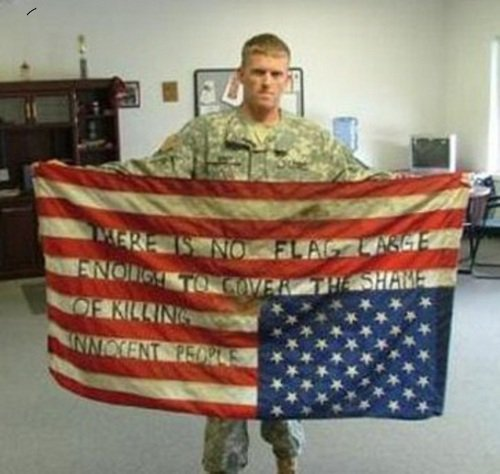 mywastedmind:   There is no flag large enough to cover the shame of killing innocent people.  the most powerful photograph I've seen.