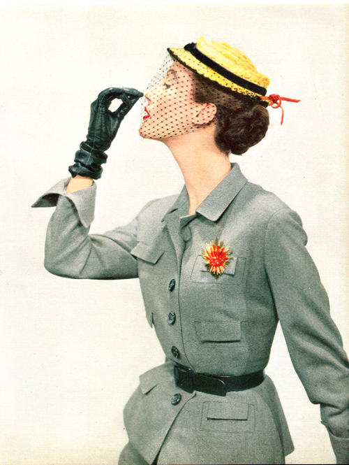 vintagegaze:  Grey Flannel Suit - Vogue Feb, 1951