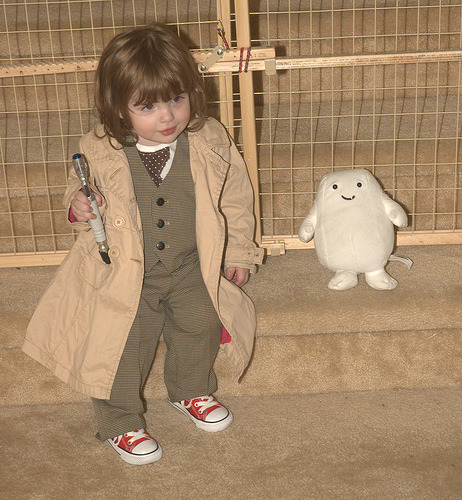 thetardis:   ..here is a picture of my daughter and a sentient blob of fat. Yes, that is her in her 10th doctor costume. This is her in all eleven costumes.  Um. Best mom EVER.  OMG HER AS 2! She's the one I've seen at Gally, and though I'm not a baby/kid person…SO CUTE!