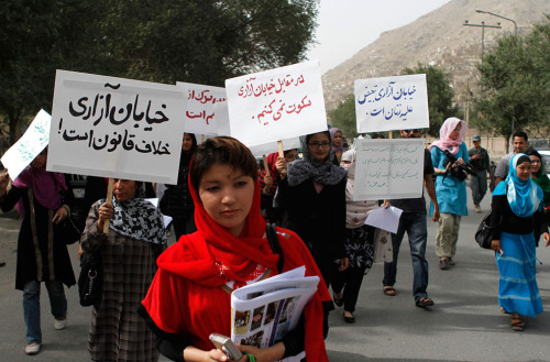 "Afghan women protest against street harassment in  Kabul, in high heels and head scarves, a small band of  Afghan women took to the streets of the country's capital Kabul on  Thursday to protest harassment by men. The signs read, ""Street violence  is illegal"" (in black), ""We will not be silent in the face of street  harassment"" (in red) and ""To disgrace women is to disgrace humanity"" (in  blue) July 14th, 2011."