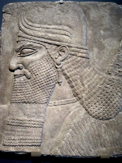 tammuz:  Neo-Assyrian relief of a winged genius from the Northwest Palace of Ashurnasirpal II (883-859 B.C.) The Art Institute of Chicago, Chicago, IL. Photo by Babylon Chronicle